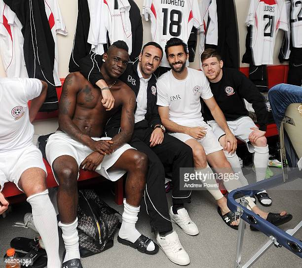 Mario Balotelli Jose Enrique Alvaro Arbeloa and Alberto Moreno in the dressing room before the Liverpool All Star Charity Match at Anfield on March...
