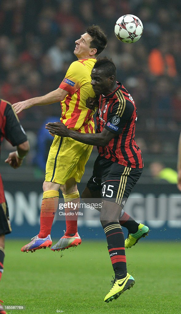 Mario Balotelli of AC Milan #45 and Lionel Messi of FC Barcelona compete for the ball during the UEFA Champions League Group H match between AC Milan and Barcelona at Stadio Giuseppe Meazza on October 22, 2013 in Milan, Italy.