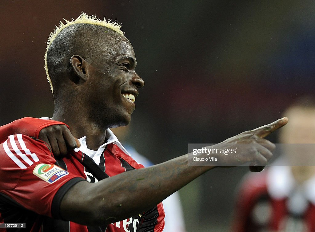Mario Balotelli of AC Milan celebrates scoring his team's fourth goal from a penalty kick during the Serie A match between AC Milan and Calcio Catania at San Siro Stadium on April 28, 2013 in Milan, Italy.