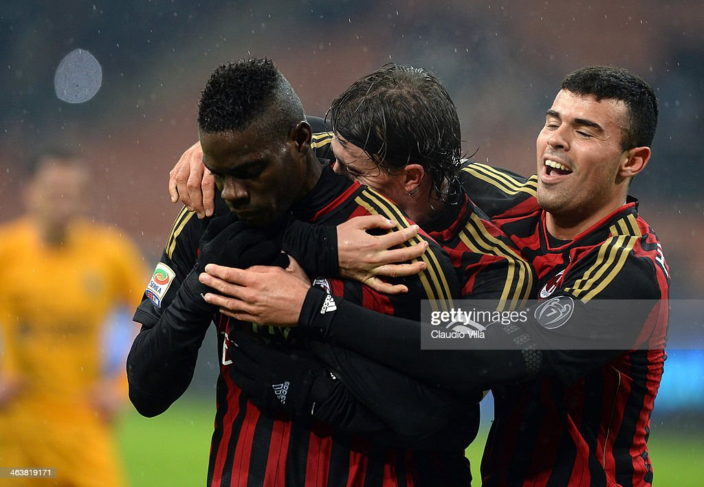 Mario Balotelli of AC Milan (L) celebrates scoring the first goal during the Serie A match between AC Milan and Hellas Verona FC at San Siro Stadium on January 19, 2014 in Milan, Italy.