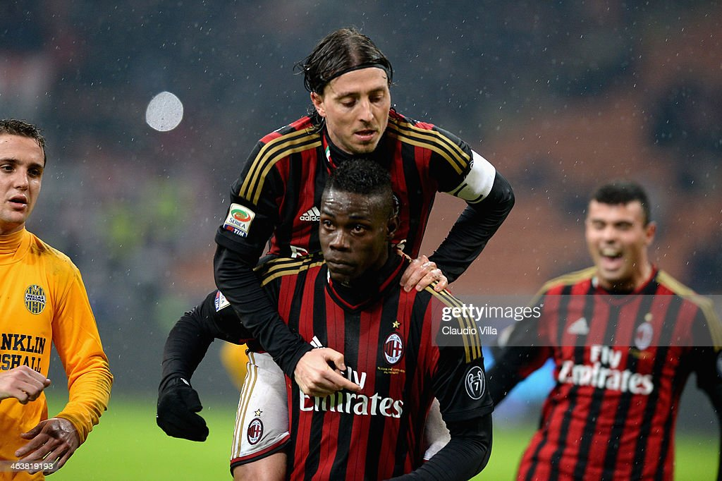 Mario Balotelli of AC Milan (Down) celebrates scoring the first goal during the Serie A match between AC Milan and Hellas Verona FC at San Siro Stadium on January 19, 2014 in Milan, Italy.