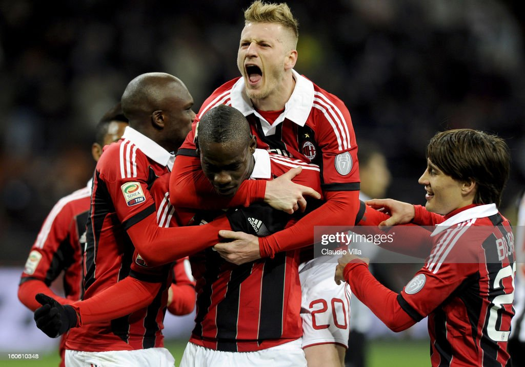 Mario Balotelli (C) of AC Milan celebrates with team-mates after scoring his second goal from the penalty spot during the Serie A match between AC Milan and Udinese Calcio at San Siro Stadium on February 3, 2013 in Milan, Italy.