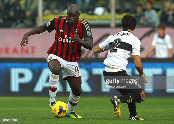 Mario Balotelli of AC Milan competes for the ball with Mattia Cassani of Parma FC during the Serie A match between Parma FC and AC Milan at Stadio...