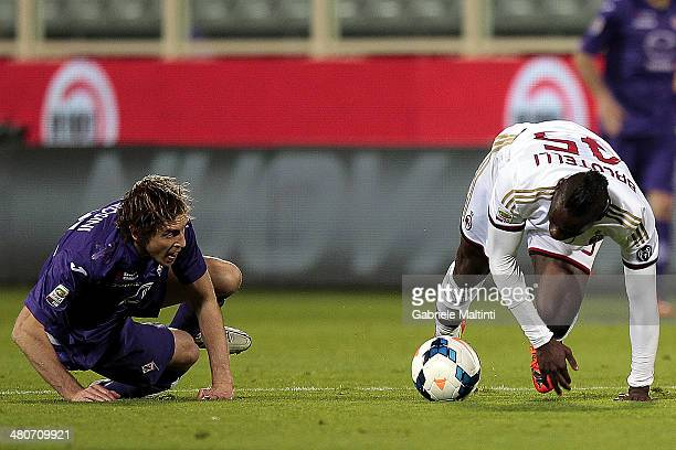 Mario Balotelli of AC Milan in action and Massimo Ambrosini of ACF Fiorentina during the serie A match between ACF Fiorentina and AC Milan at Stadio...