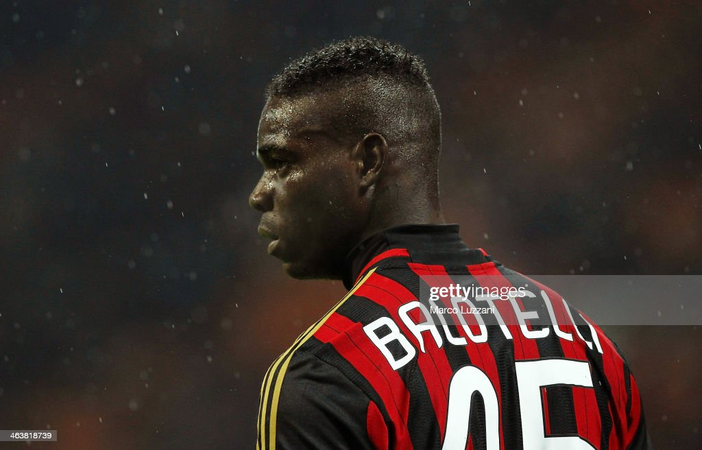 Mario Balotelli of AC Milan looks on during the Serie A match between AC Milan and Hellas Verona FC at San Siro Stadium on January 19, 2014 in Milan, Italy.