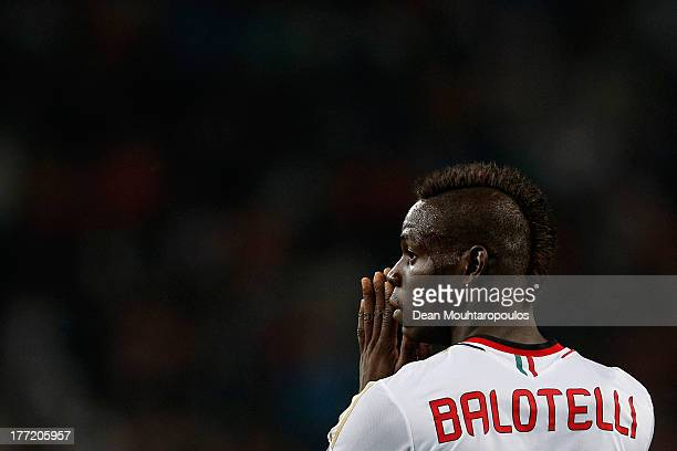 Mario Balotelli of AC Milan reacts to a missed chance during the UEFA Champions League Playoff First Leg match between PSV Eindhoven and AC Milan at...