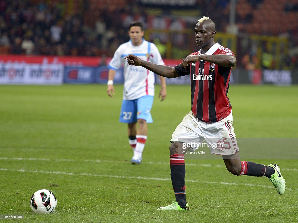 Mario Balotelli of AC Milan scores his team's fourth goal from a penalty kick during the Serie A match between AC Milan and Calcio Catania at San Siro Stadium on April 28, 2013 in Milan, Italy.