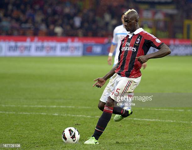 Mario Balotelli of AC Milan scores his team's fourth goal from a penalty kick during the Serie A match between AC Milan and Calcio Catania at San...