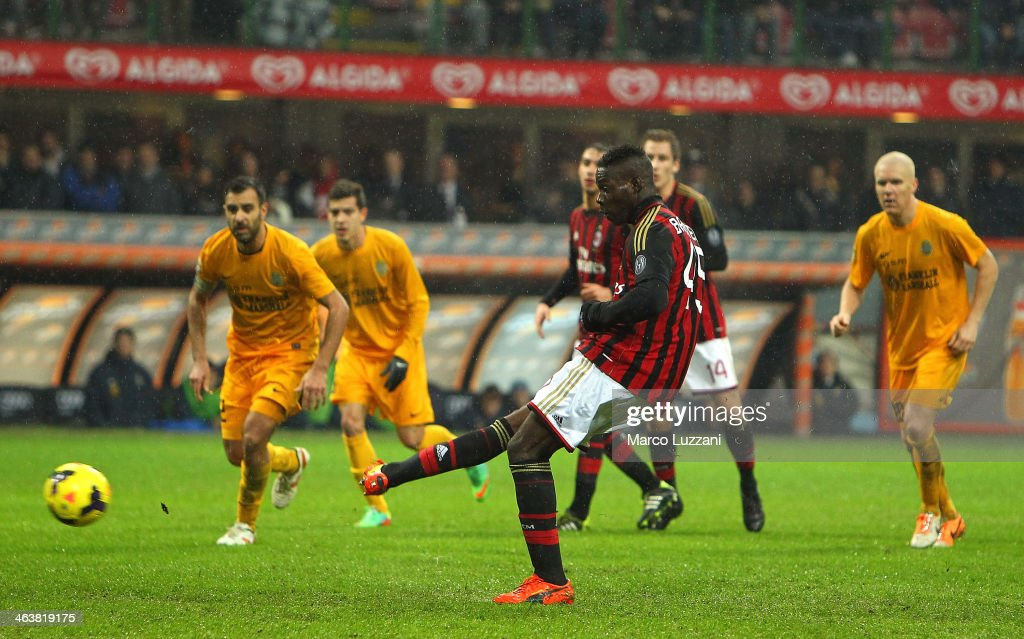 Mario Balotelli of AC Milan scores the opening from the penalty spot during the Serie A match between AC Milan and Hellas Verona FC at San Siro Stadium on January 19, 2014 in Milan, Italy.