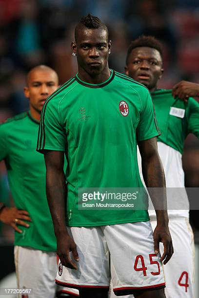Mario Balotelli of AC Milan warms up prior to the UEFA Champions League Playoff First Leg match between PSV Eindhoven and AC Milan at PSV Stadion on...