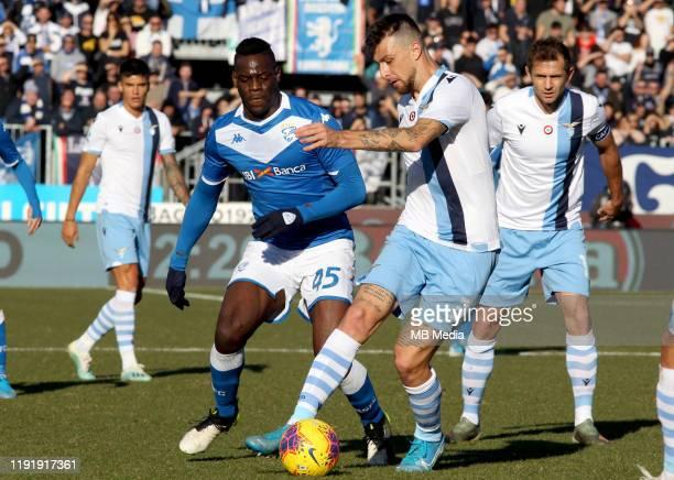 Mario Balotelli of Brescia Calcio competes for the ball with Francesco Acerbi of SS Lazio during the Serie A match between Brescia Calcio FC and SS...