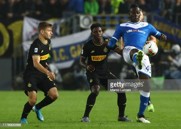 Mario Balotelli of Brescia Calcio competes for the ball with Kwadwo Asamoah anf Nicolo Barella of FC Internazionale during the Serie A match between...