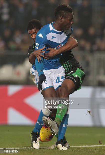 Mario Balotelli of Brescia Calcio competes for the ball with Marlon of US Sassuolo during the Serie A match between Brescia Calcio and US Sassuolo at...