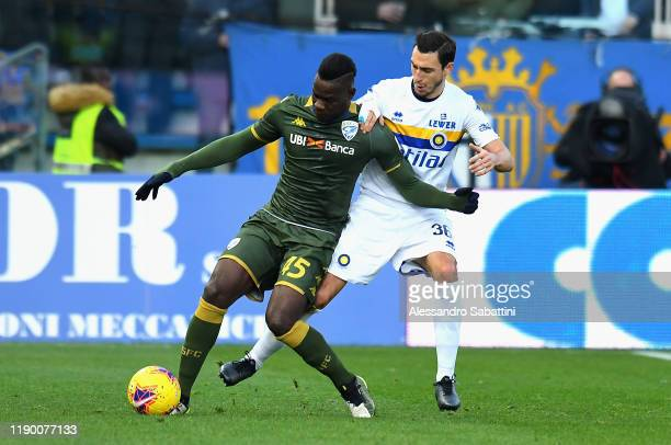 Mario Balotelli of Brescia Calcio competes for the ball with Matteo Darmian of Parma Calcio during the Serie A match between Parma Calcio and Brescia...
