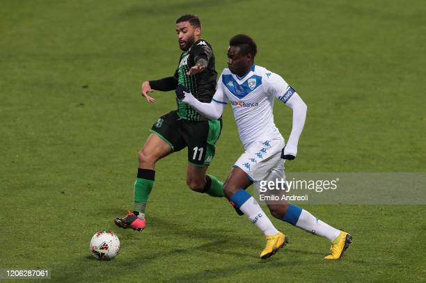 Mario Balotelli of Brescia Calcio is challenged by Gregoire Defrel of US Sassuolo during the Serie A match between US Sassuolo and Brescia Calcio at...