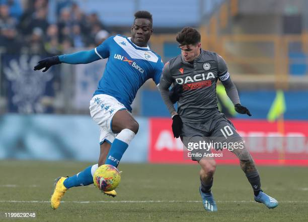Mario Balotelli of Brescia Calcio is challenged by Rodrigo De Paul of Udinese Calcio during the Serie A match between Brescia Calcio and Udinese...