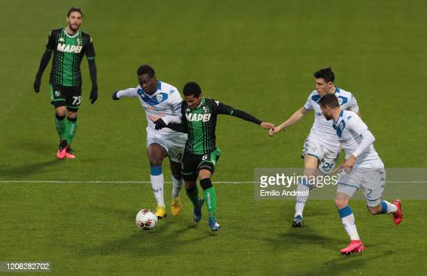 Mario Balotelli of Brescia Calcio is challenged by Rogerio of US Sassuolo during the Serie A match between US Sassuolo and Brescia Calcio at Mapei...
