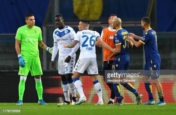 Mario Balotelli of Brescia Calcio reacts to racist chants from Verona fans during the Serie A match between Hellas Verona and Brescia Calcio at...