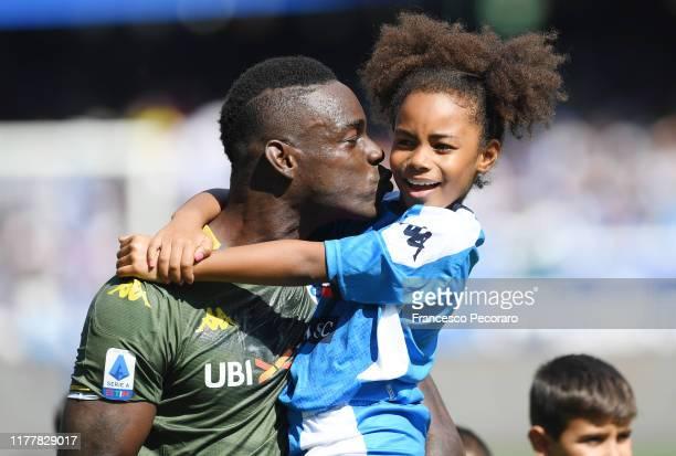 Mario Balotelli of Brescia Calcio with his daughter Pia before the Serie A match between SSC Napoli and Brescia Calcio at Stadio San Paolo on...