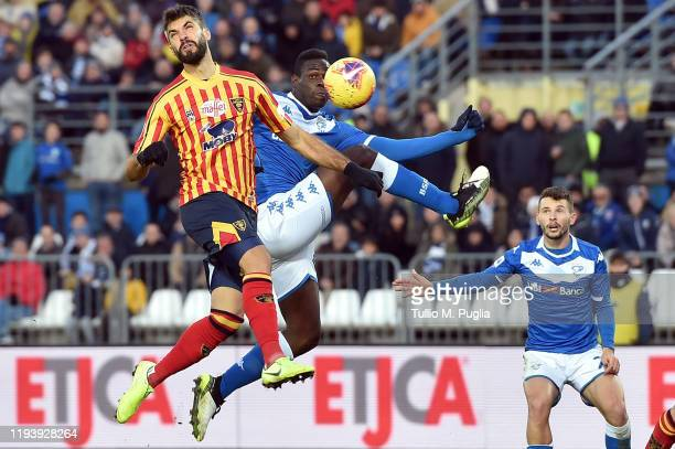 Mario Balotelli of Brescia controls the the ball as Luca Sorrettini of Lecce tackles during the Serie A match between Brescia Calcio and US Lecce at...