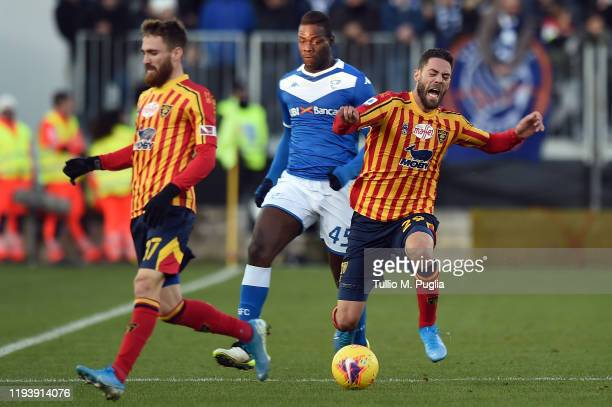 Mario Balotelli of Brescia fouls Andrea Rispoli of Lecce during the Serie A match between Brescia Calcio and US Lecce at Stadio Mario Rigamonti on...