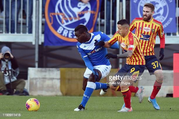 Mario Balotelli of Brescia is challenged by Gianluca Lapadula of Lecce during the Serie A match between Brescia Calcio and US Lecce at Stadio Mario...