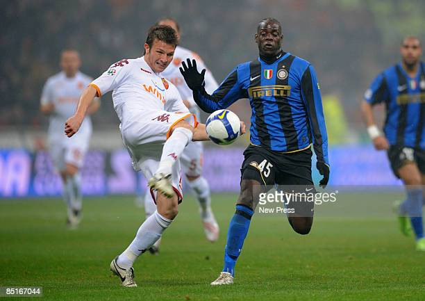 Mario Balotelli of Inter Milan and Marco Motta of Roma in action during the Serie A match between Inter and Roma at the Stadio Meazza on March 01...
