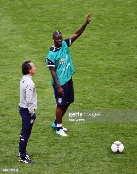 Mario Balotelli of Italy and head coach Cesare Prandelli attend a UEFA EURO 2012 training session ahead of their Group C match against Spain at the...
