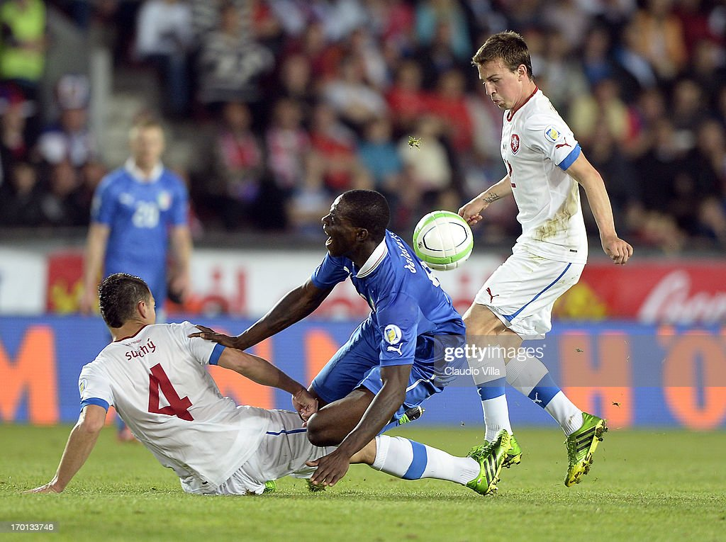 Mario Balotelli of Italy and Marek Suchy of Czech Republic #4 compete for the ball during the FIFA 2014 World Cup Qualifier group B match between Czech Republic and Italy at Generali Arena on June 7, 2013 in Prague, Czech Republic.