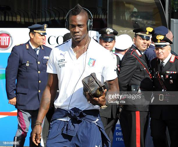 Mario Balotelli of Italy arrives before of a training session ahead of their FIFA World Cup qualifier against Armenia on October 14 2013 in Naples...