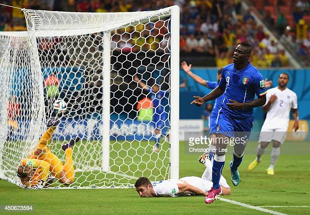 Mario Balotelli of Italy celebrates after scoring his team's second goal on a header past Gary Cahill and goalkeeper Joe Hart of England during the...