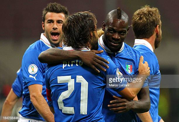 Mario Balotelli of Italy celebrates his goal with teammates Andrea Pirlo during the FIFA 2014 World Cup qualifier match between Italy and Denmark at...