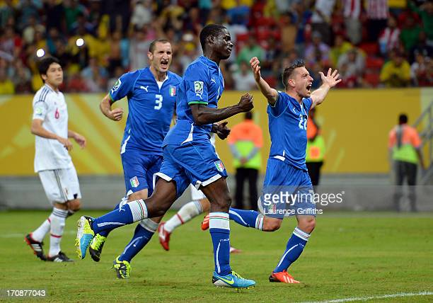 Mario Balotelli of Italy celebrates scoring his team's third goal with Emanuele Giaccherini during the FIFA Confederations Cup Brazil 2013 Group A...