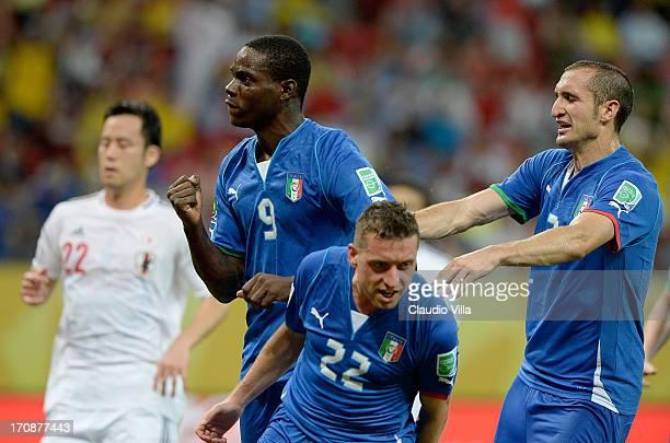 Mario Balotelli of Italy celebrates scoring his team's third goal with teammates Emanuele Giaccherini and Giorgio Chiellini during the FIFA...