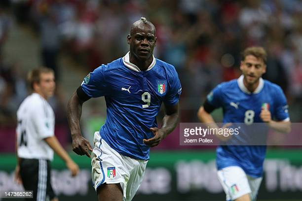 Mario Balotelli of Italy celebrates scoring the opening goal during the UEFA EURO 2012 semi final match between Germany and Italy at the National...
