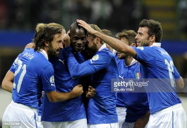 Mario Balotelli of Italy celebrates with team-mates after scoring the third goal during the FIFA 2014 World Cup Qualifier group B match between Italy...