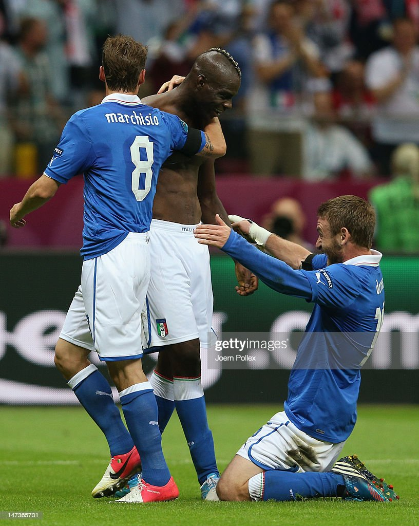 Mario Balotelli (C) of Italy celebrates with team-mates Claudio Marchisio (L) and Daniele De Rossi after scoring his team's second goal during the UEFA EURO 2012 semi final match between Germany and Italy at the National Stadium on June 28, 2012 in Warsaw, Poland.