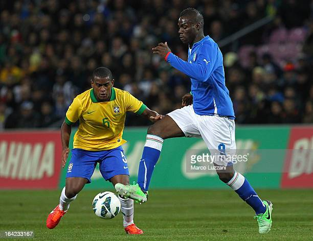 Mario Balotelli of Italy competes for the ball with Fernando of Brazil during the international friendly match between Italy and Brazil on March 21...