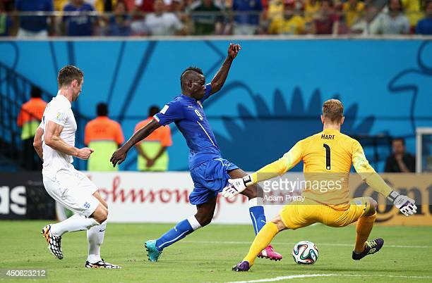 Mario Balotelli of Italy controls the ball against goalkeeper Joe Hart of England during the 2014 FIFA World Cup Brazil Group D match between England...