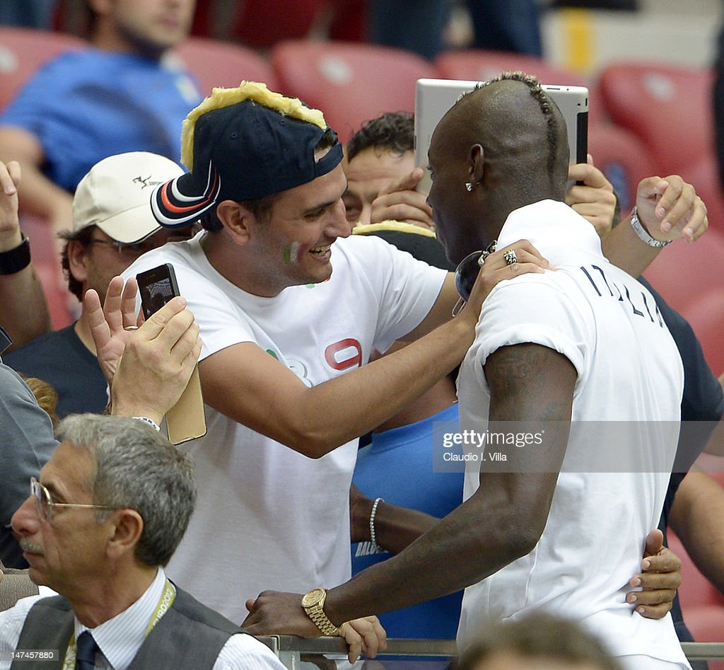 Mario Balotelli of Italy greets his adoptive brother Giovanni Balotelli (L) during the UEFA EURO 2012 semi final match between Germany and Italy at National Stadium on June 28, 2012 in Warsaw, Poland.