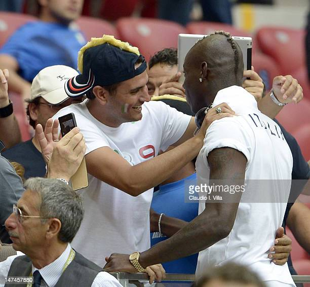 Mario Balotelli of Italy greets his adoptive brother Giovanni Balotelli during the UEFA EURO 2012 semi final match between Germany and Italy at...