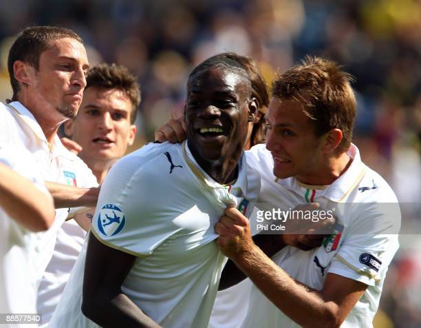 Mario Balotelli of Italy is congratulated after scoring during the UEFA U21 European Championships match between Sweden and Italy at the Olympia on...