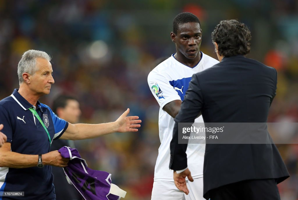 Mario Balotelli of Italy is congratulated by Cesare Prandelli head coach of Italy at the end of the FIFA Confederations Cup Brazil 2013 Group A match between Mexico and Italy at the Maracana Stadium on June 16, 2013 in Rio de Janeiro, Brazil.