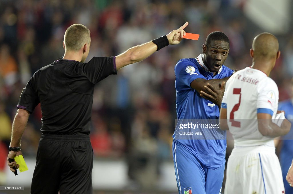 Mario Balotelli of Italy (2nd R) is shown a red card by referee Svein Oddvar Moen during the FIFA 2014 World Cup Qualifier group B match between Czech Republic and Italy at Generali Arena on June 7, 2013 in Prague, Czech Republic.