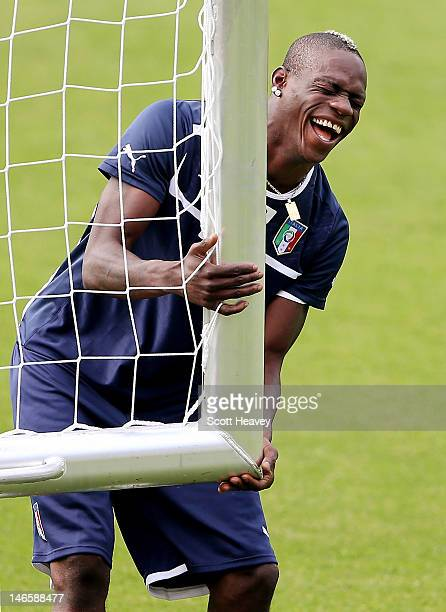 Mario Balotelli of Italy laughs during a training session ahead of their UEFA EURO 2012 quarterfinal against England at Marshal Józef Pilsudski...