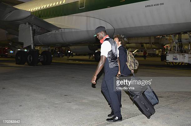 Mario Balotelli of Italy leaves the plane upon his arrival at Rio de Janeiro Galeao International airport on June 10 2013 in Rio de Janeiro Brazil