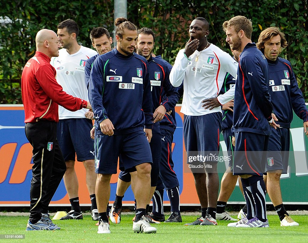 Mario Balotelli (3rd R ) of Italy looks on during a training session at Coverciano on November 8, 2011 in Florence, Italy.