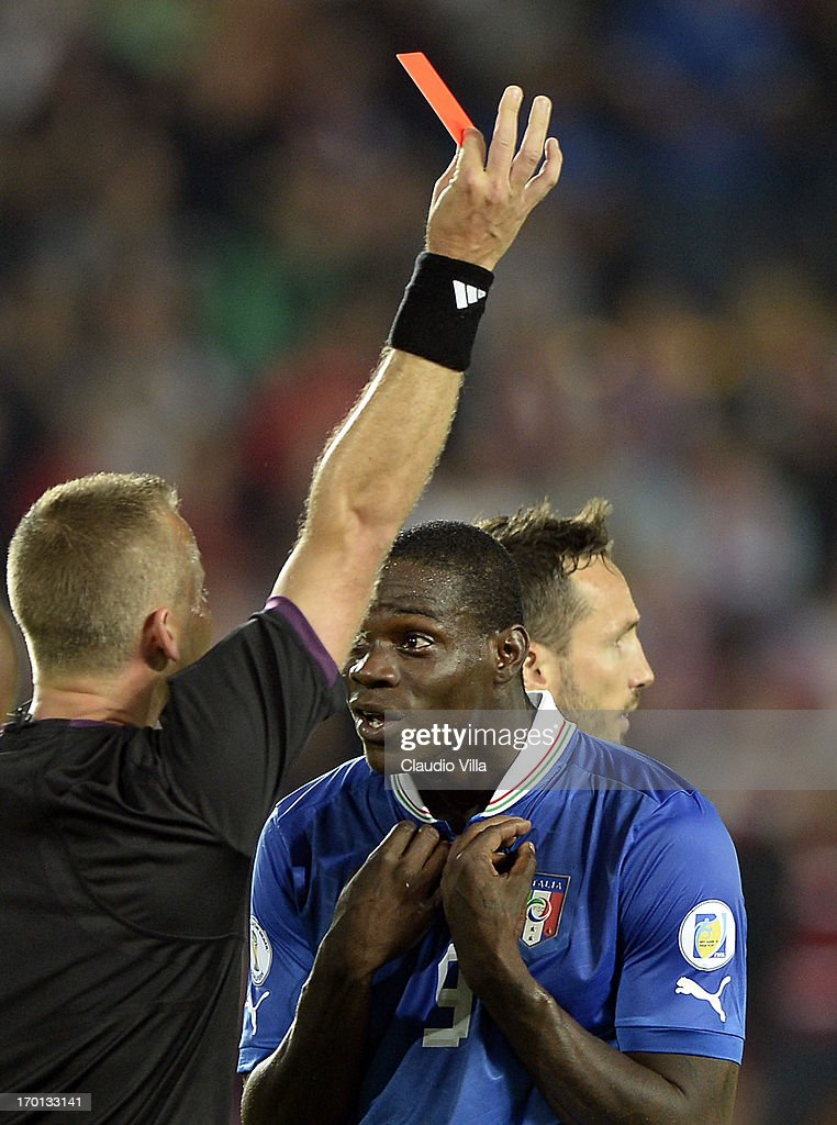 Mario Balotelli of Italy reacts as he is shown a red card by referee Svein Oddvar Moen during the FIFA 2014 World Cup Qualifier group B match between Czech Republic and Italy at Generali Arena on June 7, 2013 in Prague, Czech Republic.