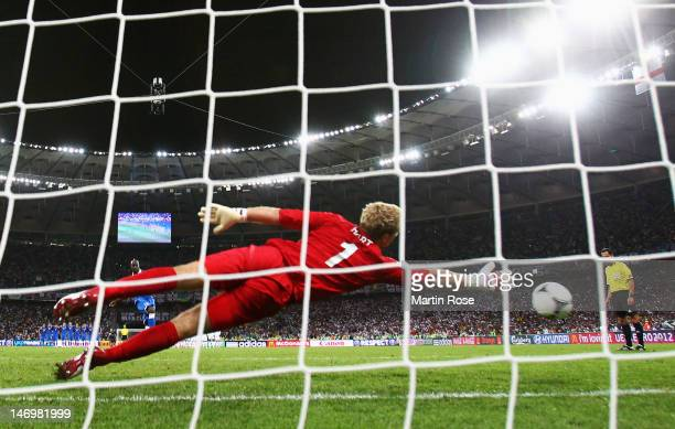 Mario Balotelli of Italy scores his penalty past Joe Hart of England in the shootout during the UEFA EURO 2012 quarter final match between England...