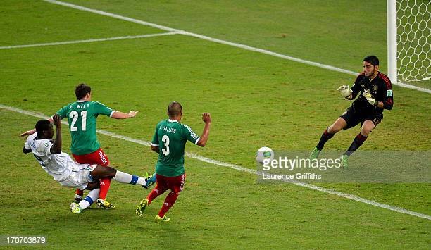 Mario Balotelli of Italy scores his team's second goal past Jose de Jesus Corona of Mexico during the FIFA Confederations Cup Brazil 2013 Group A...